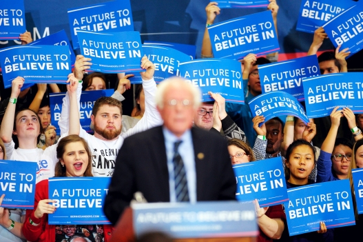 Supporters hold signs and cheer as U.S. Democratic presidential candidate Sanders speaks during a campaign rally at Cornell College in Mount Vernon, Iowa