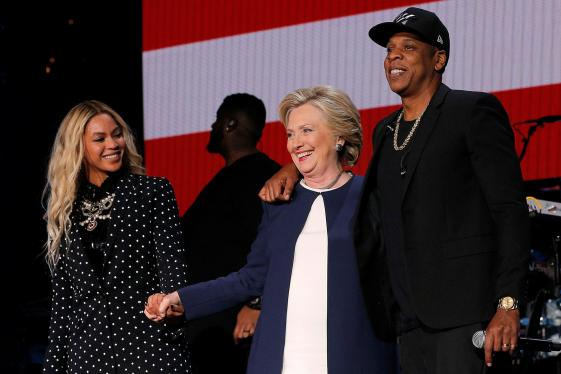U.S. Democratic presidential nominee Hillary Clinton joins Jay Z and Beyonce onstage at a campaign concert in Cleveland
